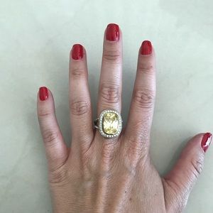 Silver and yellow stone costume jewelry ring